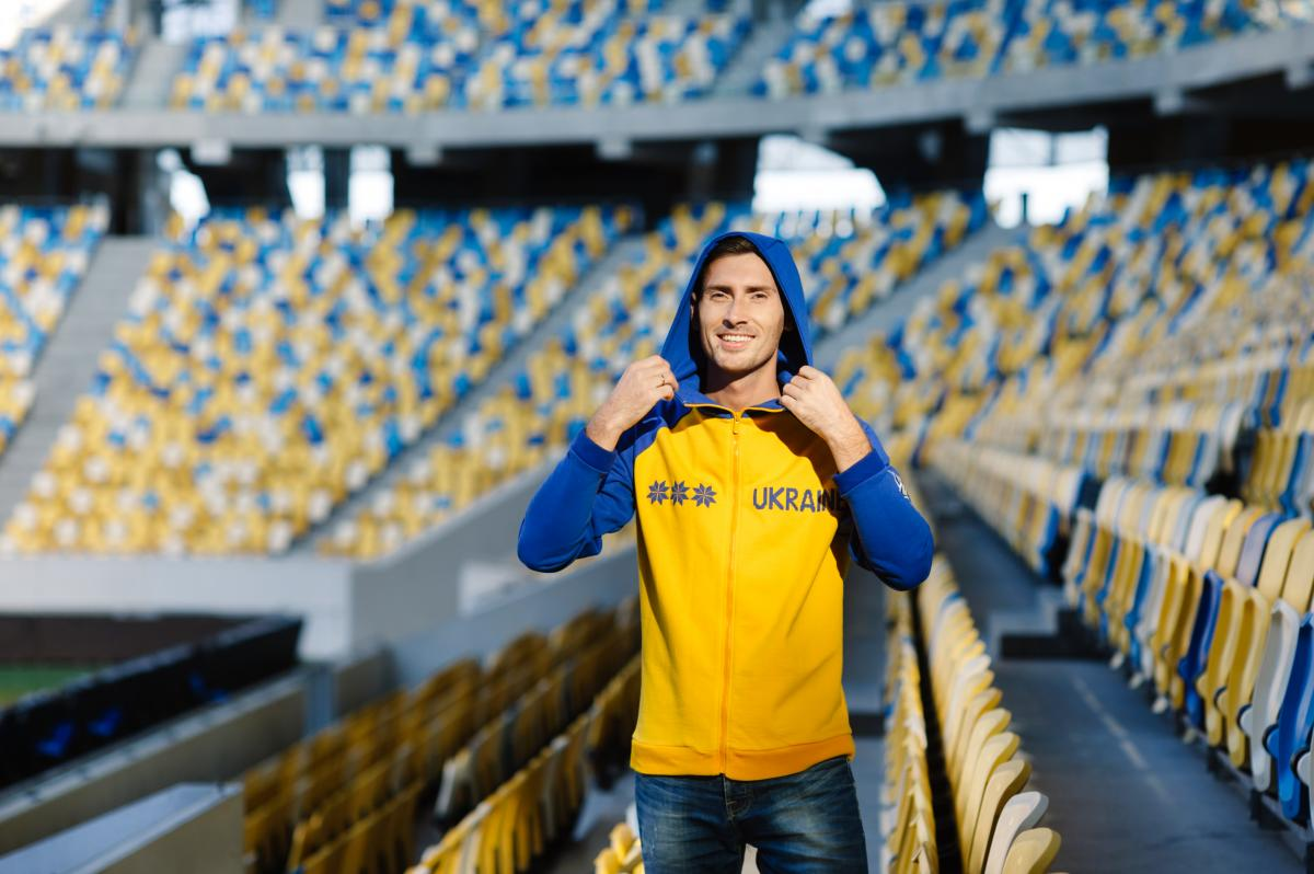 Men's jacket in national colors with hashtags Ukraine. Photo №1. | Narodnyi dim Ukraine