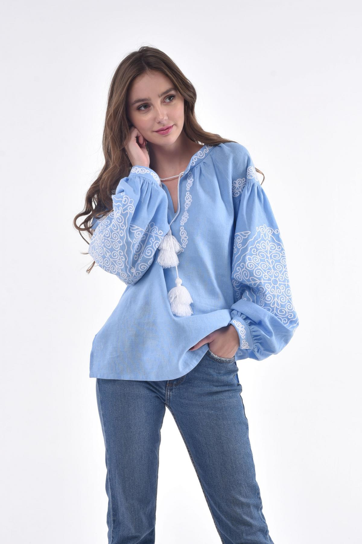 Embroidered blue linen shirt with white embroidery