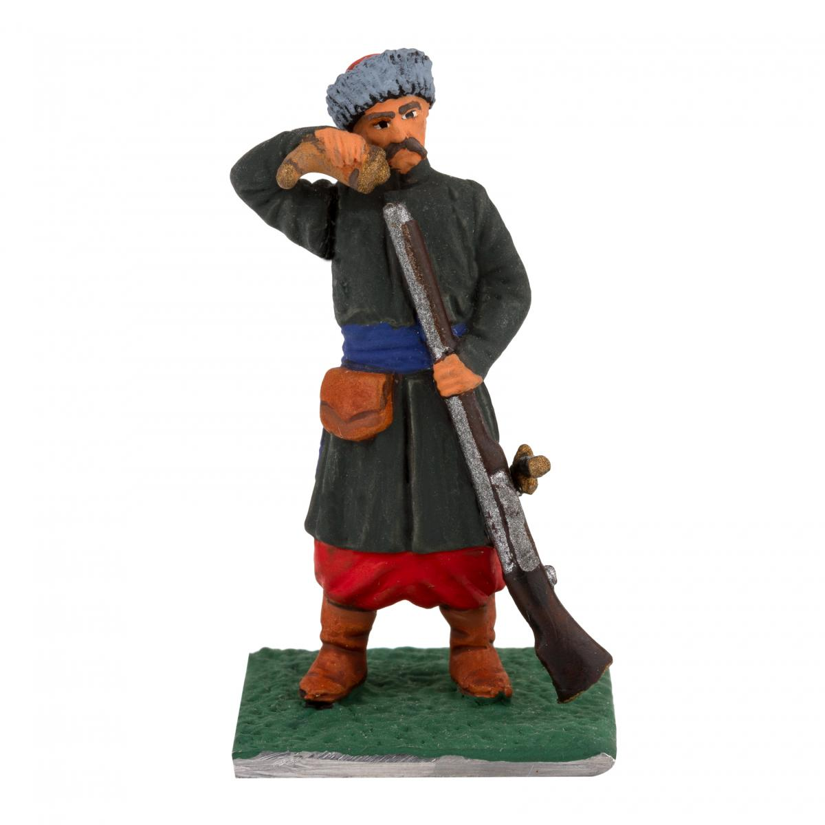 Фигурка мужчины с винтовкой