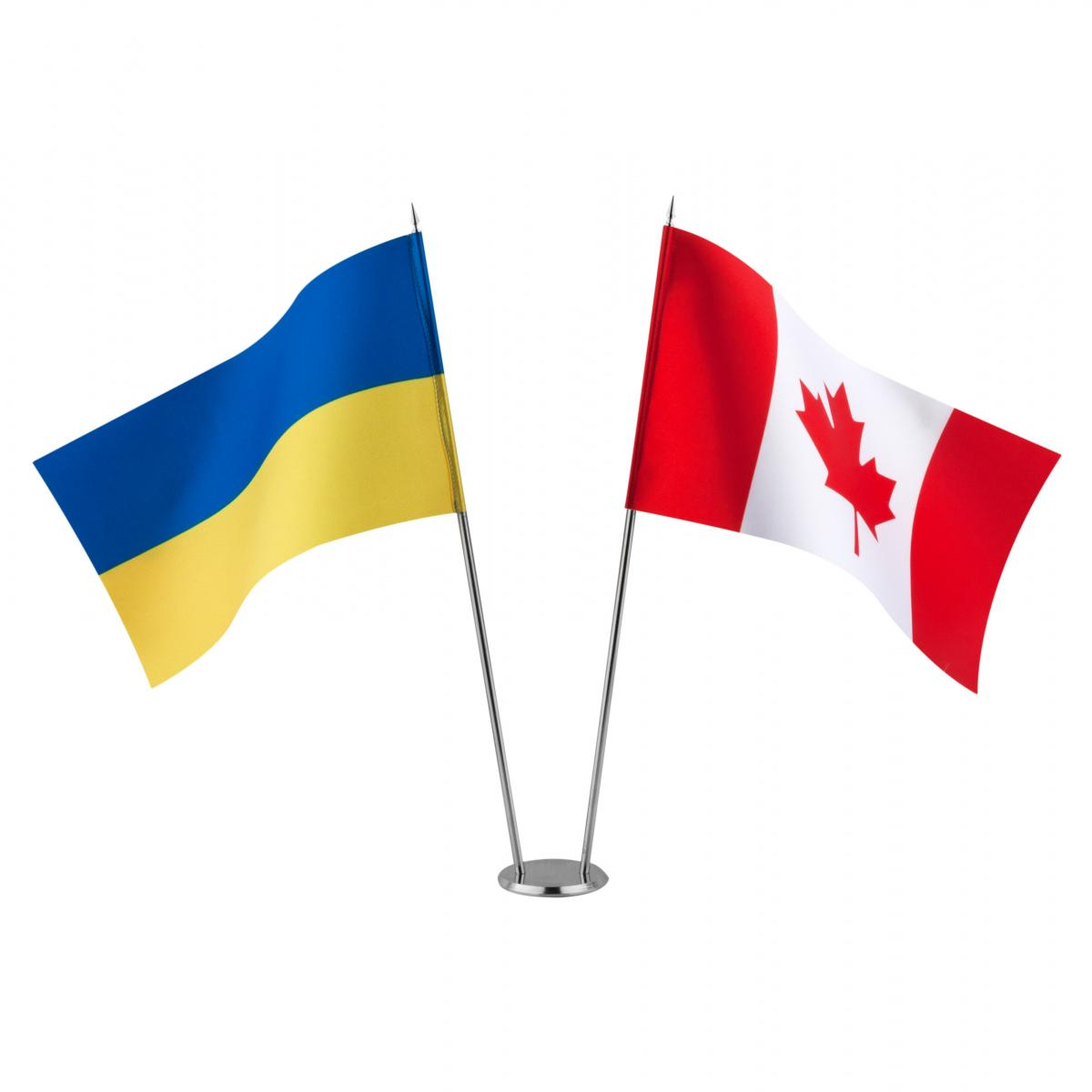 Flags of Ukraine and Canada on the stand