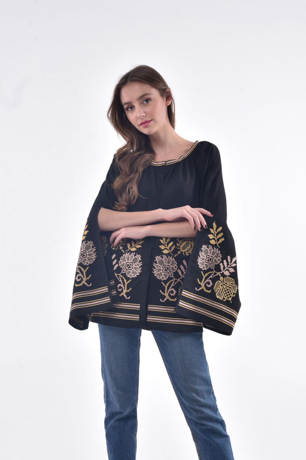 Black embroidery with luscious sleeves with a cut