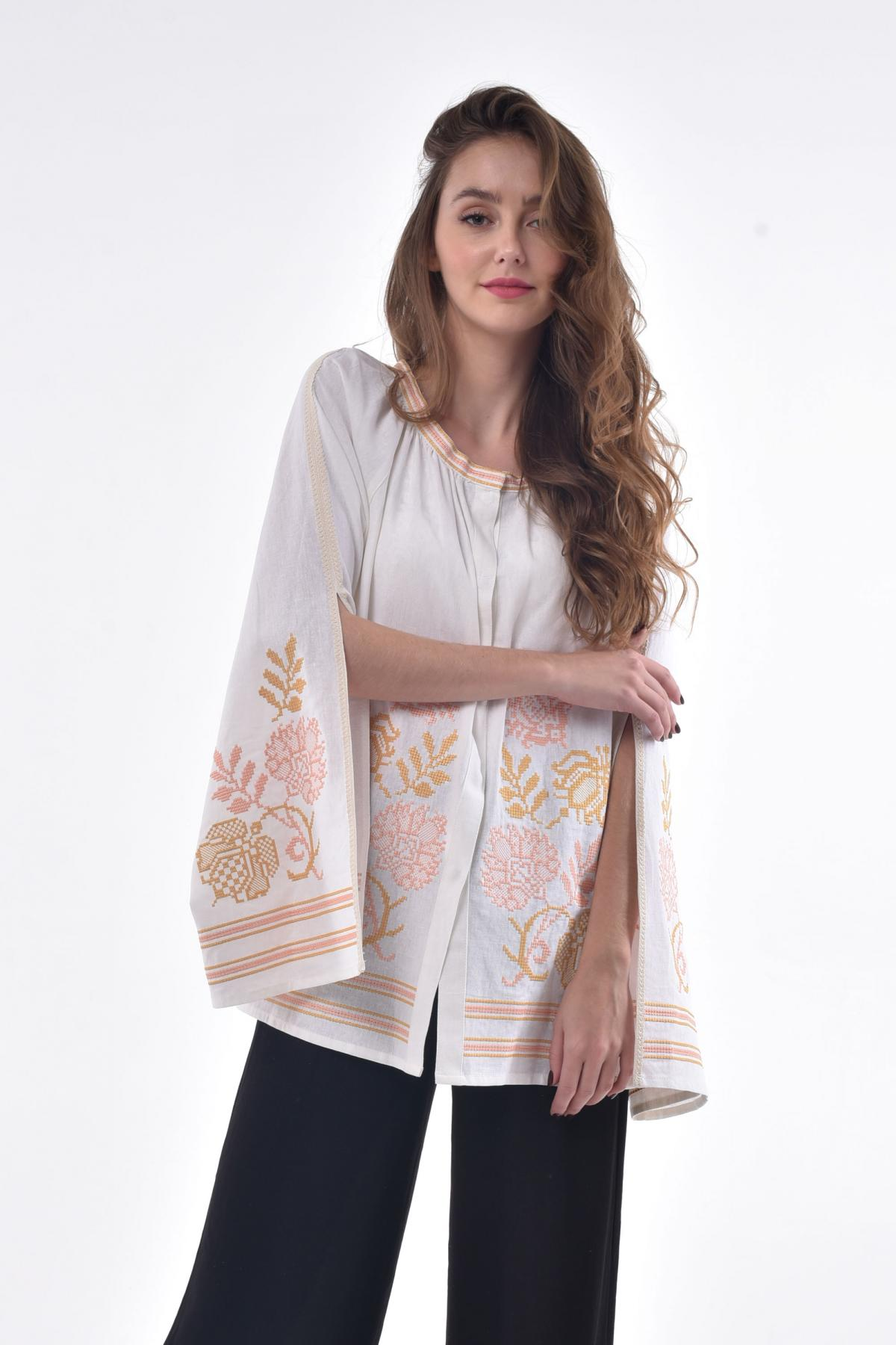 White embroidered shirt with lush, spectacular sleeves with a cut