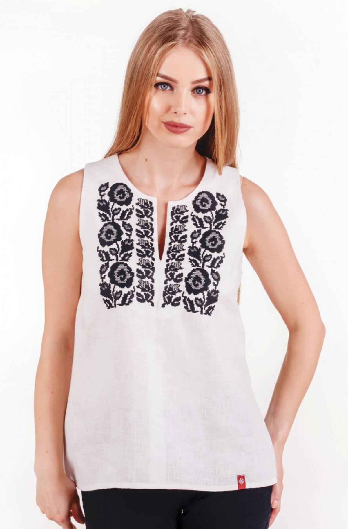White sleeveless embroidery