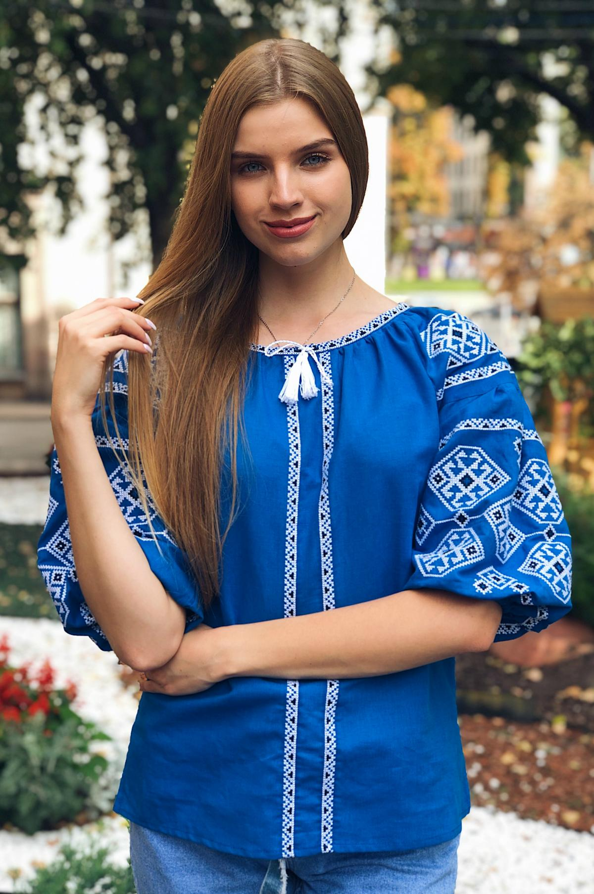 Bright light blue female embroidery with 3/4 sleeve
