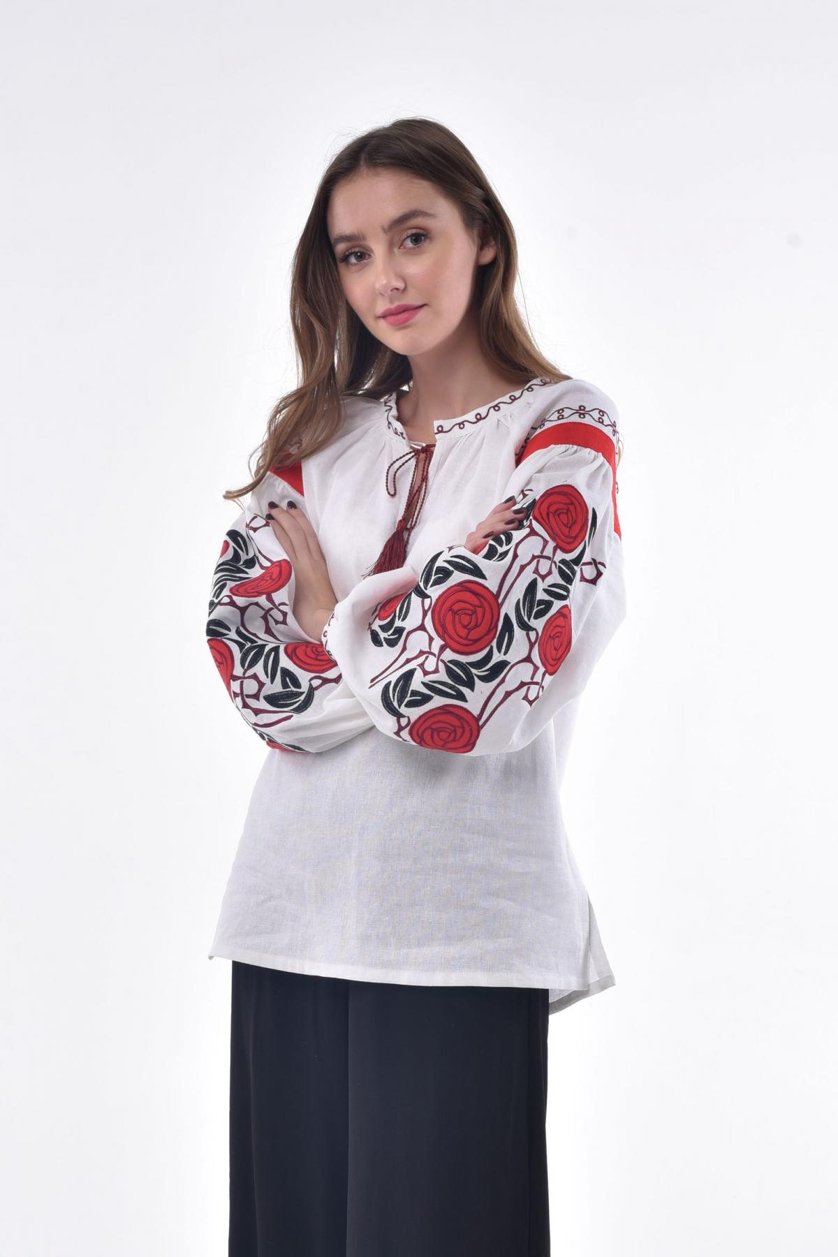 White female embroidery with wild roses