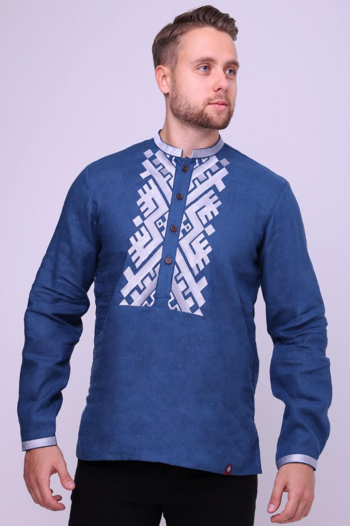 Men's blue embroidered shirt with white embroidery. Photo №1. | Narodnyi dim Ukraine
